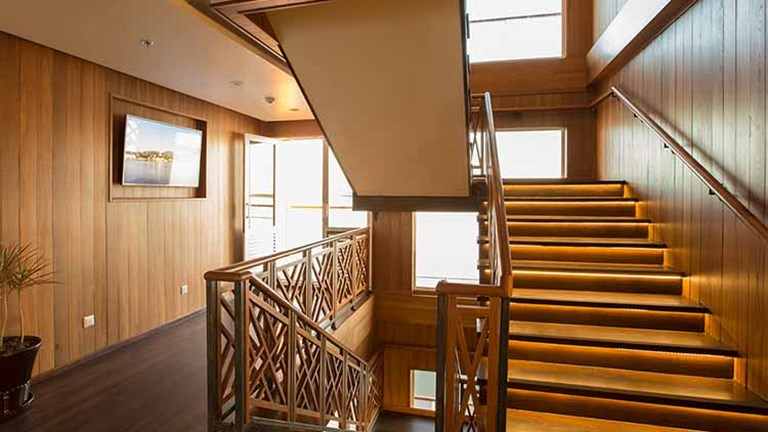 Wood accents are used throughout Avalon Myanmar. // © 2016 Avalon Waterways