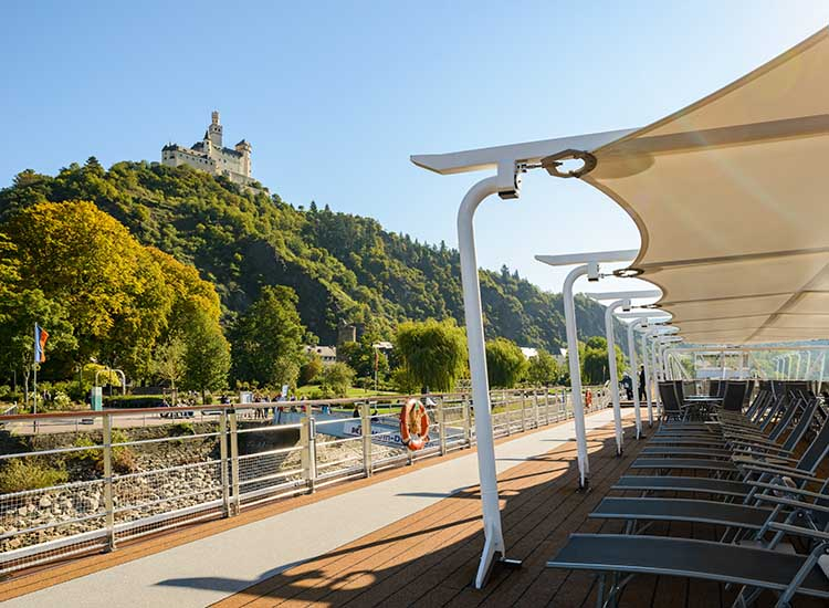 Guests on Hild's Rhine Getaway itinerary can take in views of the 700-year-old Marksburg Castle from the ship's top-deck lounge chairs, the tour the UNESCO World Heritage Site. // © 2017 Viking River Cruises