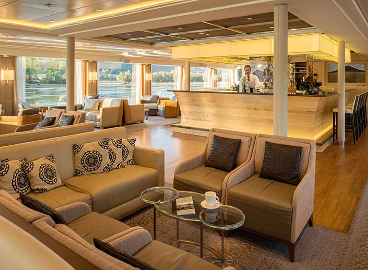 The Observation Lounge offers a bar; comfortable seating and tables; and a pianist to serenade guests. // © 2017 Viking River Cruises