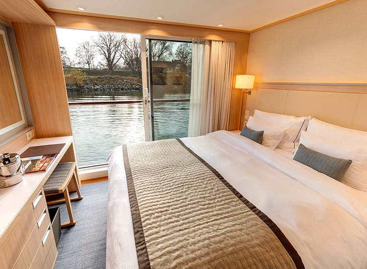 While in a French balcony stateroom, cruisers can watch the river flow by while enjoying the clean lines and muted color palettes of Scandinavian design. // © 2017 Viking River Cruises