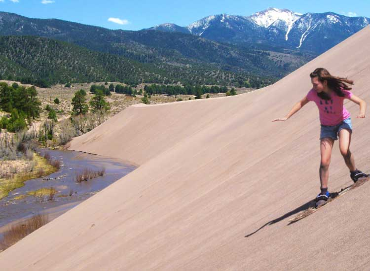 Adventure seekers can try sandboarding in the park. // © 2014 Great Sand Dunes National Park & Preserve