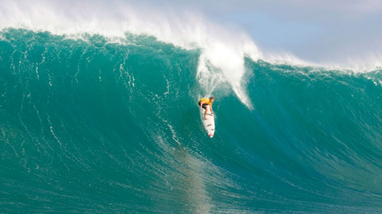 Professional big wave surfer Mark Healey rides down the 30-foot-plus face of a Waimea Bay wave // © 2014  Quiksilver/Noyle