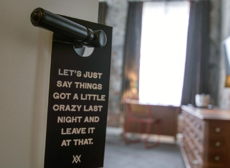 A clever door hanger at the hip new Provence Hotel // © 2015 NewOrleansOnline.com