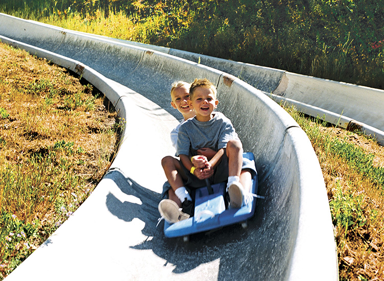 With four tracks to choose from, the Alpine Slide at Park City Mountain Resort is more than 3,000 feet of exhilaration. // © 2014 Park City Chamber/Convention and Visitors Bureau