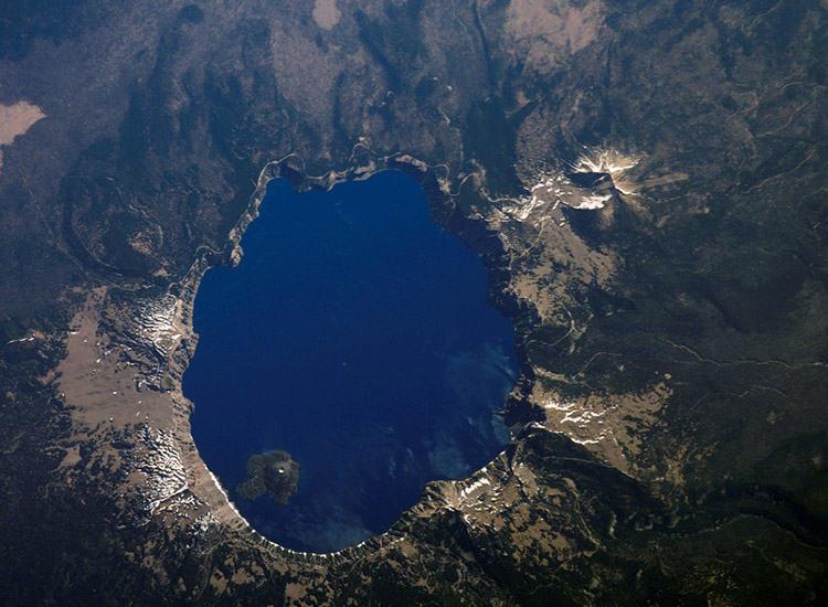 Shown in this shot from above captured by NASA, Crater Lake National Park is Oregon's only national park. // © 2016 Creative Commons user nasamarshall