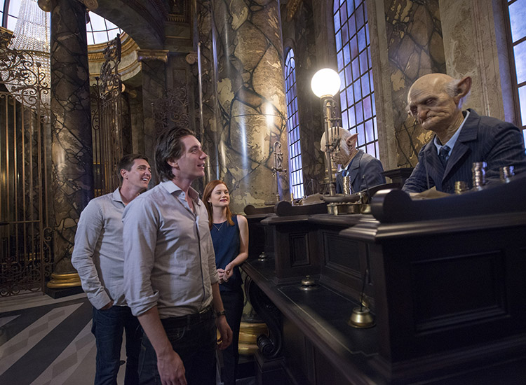 Actors Bonnie Wright, James Phelps and Oliver Phelps, who play Ginny Weasley, Fred Weasley and George Weasley, respectively, spend time with the goblins that operate Gringotts Wizarding Bank. // © 2014 Universal Orlando