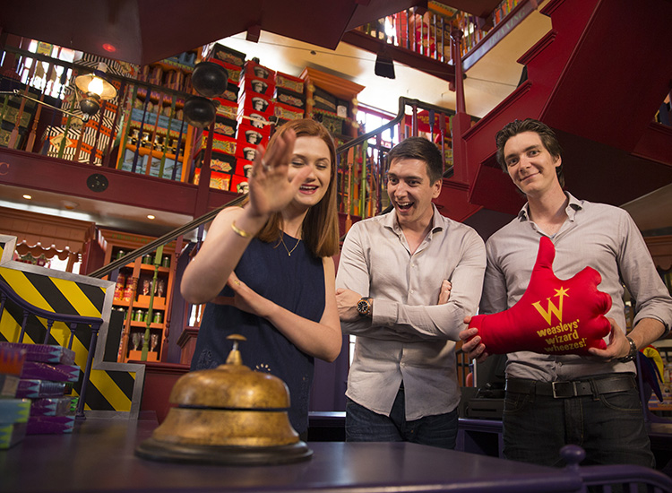 Inside the shop, Wright, James and Oliver test out the mischievous and magical merchandise. // © 2014 Universal Orlando
