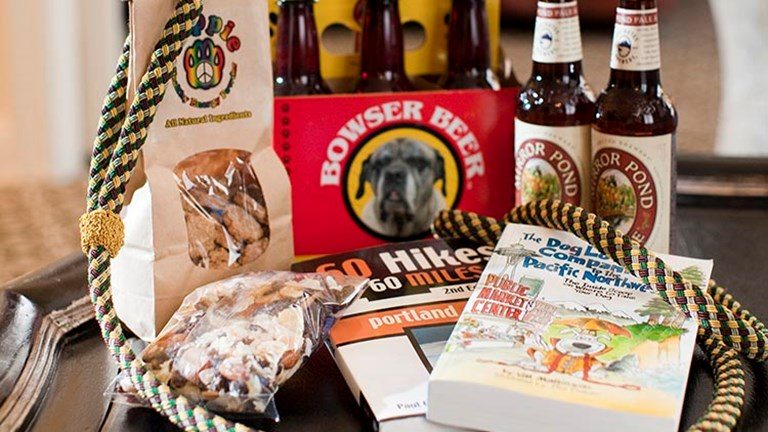 Guests at the Kimpton hotel can treat their pets to a gift basket with dog beers, treats and maps featuring pet-friendly hiking trails. // © 2017 Kimpton Hotel Monaco Portland