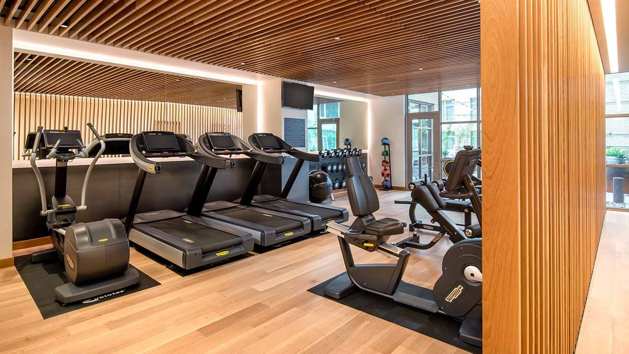 The Duniway's fitness room features multiple treadmill and elliptical machines, as well as weight sets and medicine balls.