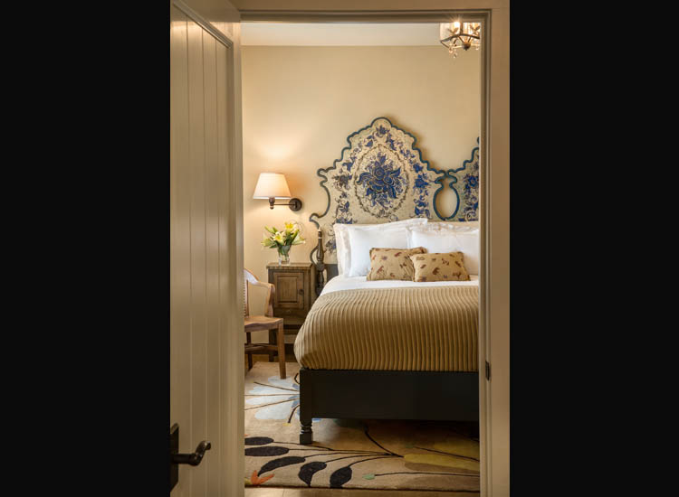 Because the original property featured twin beds, new king-size headboards were created by combining two headboards. // © 2014 Ryan Heffernan