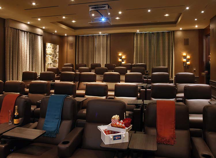 Clients can sit back and enjoy elevated movie treats in the screening room. // © 2017 Four Seasons Hotel Los Angeles at Beverly Hills