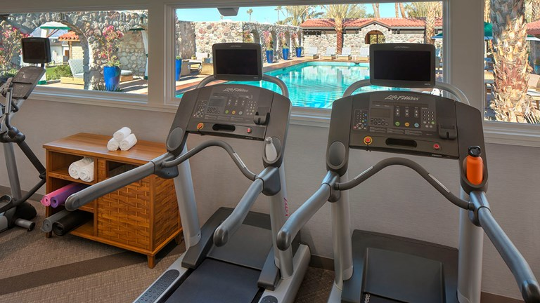 The on-site fitness center is located next to the pool and features basic equipment.