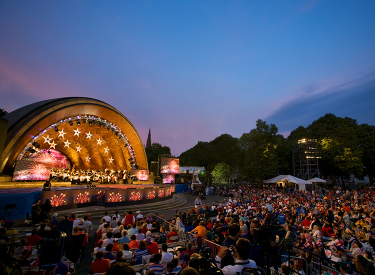 The Hatch Shell concert venue on the Charles River Esplanade hosts Boston's biggest fireworks show, the Boston Pops Firework Spectacular. // © 2014 Greater Boston Convention & Visitors Bureau