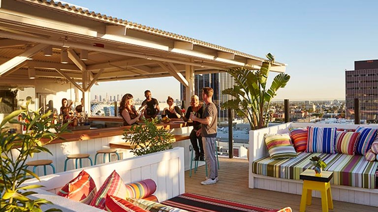 Thanks to its easygoing vibe and fun decor, Mama Shelter Rooftop Bar (opened in April 2016) is a popular weekend locale in Hollywood. // © 2017 Mama Shelter Los Angeles