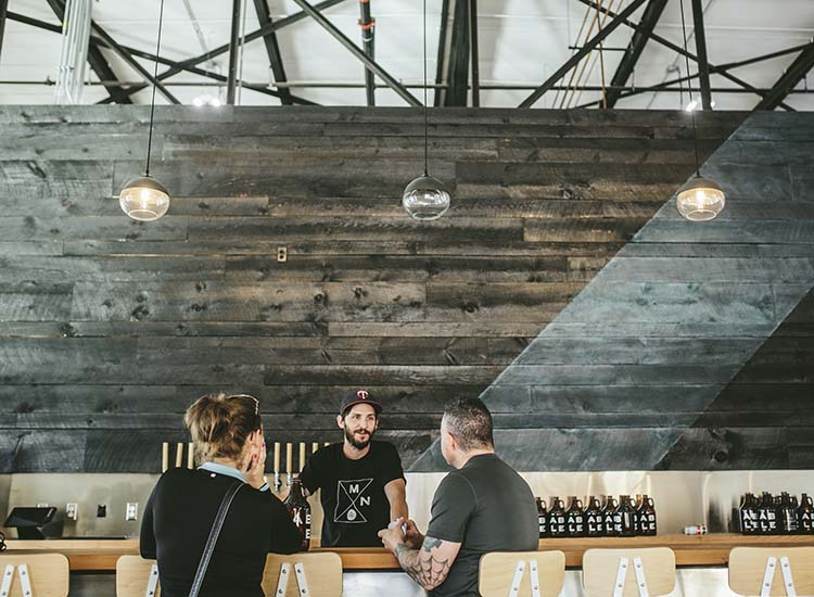 Able Seedhouse + Brewery's design includes concrete furniture and Japanese burnt wood. // © 2016 Brandon Werth