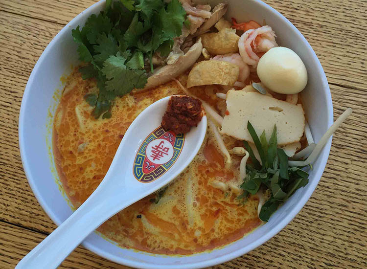 Laksa (coconut curry) soup is a top choice among customers at Satay Brothers. // © 2016 Satay Brothers