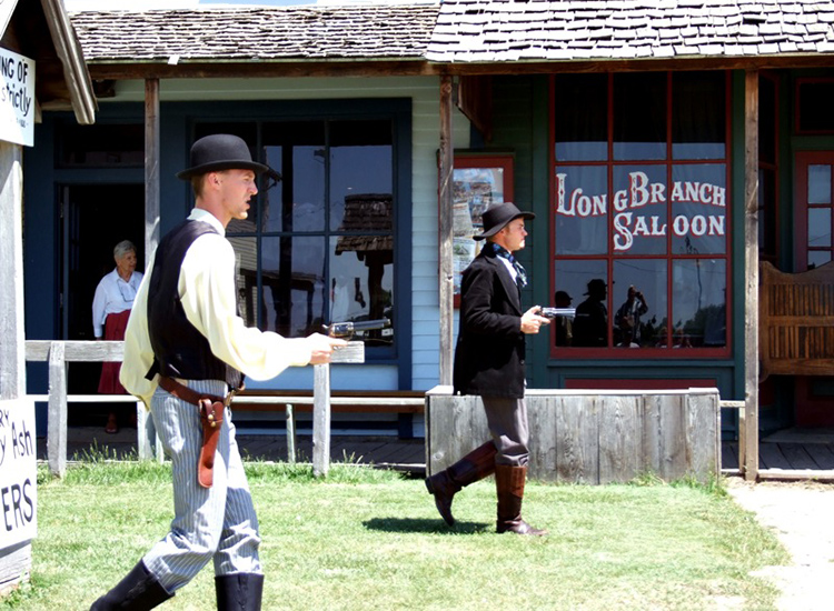 Gunslingers at Boothill Museum in Dodge City, Kan., entertain visitors. // © 2015 Creative Commons user josephleenovak