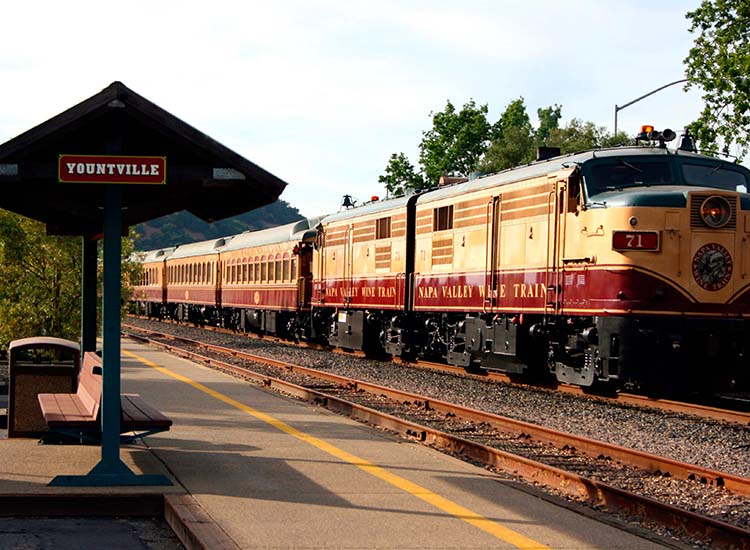 The Napa Wine Train takes passengers through Napa Valley onboard restored vintage Pullman railcars. // © 2017 Napa Wine Train