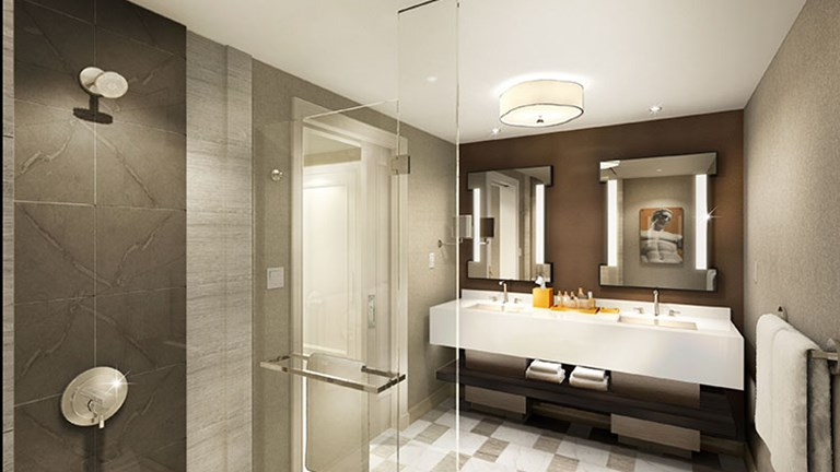 Redesigned bathrooms in the Julius Tower at Caesars Palace Las Vegas feature stone tile and modern artwork. // © 2016 Caesars Entertainment