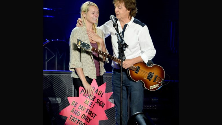 Paul McCartney invited a fan onstage during a break from his set which included many songs by The Beatles. // (c)  Jeff Kravitz/FilmMagic