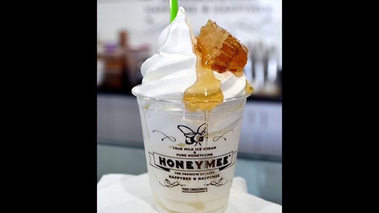 HoneyMee's soft-serve ice cream is dressed up with natural, raw honey and honeycombs. // © 2016 Creative Commons user jpellgen