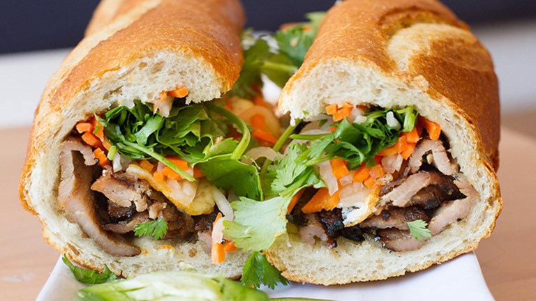 At Nong La, patrons chow down on vibrant Vietnamese food, including banh mi sandwiches, pho soup and more. // © 2016 Platful/Nong La