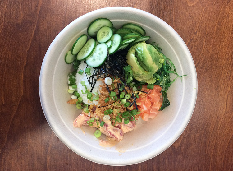 At Sea Salt Poke, order generous portions of protein of poke-style fish, with toppings such as crispy onions, cucumbers, avocado, green onions, edamame and more. // © 2016 Emma Weissmann