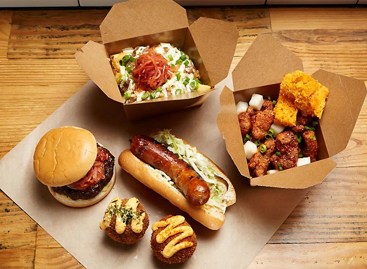 Choose from Seoul Sausage company's array of flavorful dishes, including rice balls, Korean fried chicken, short rib poutine and, of course, sausages. // © 2016 Seoul Sausage
