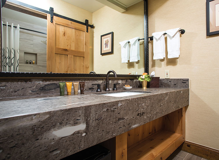 Updates to bathrooms include granite countertops and barn-inspired doors. // © 2016 Tenaya Lodge