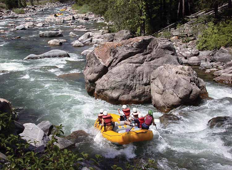 Whitewater rafting on the Gallatin River is a prime way to get up close with Big Sky's natural beauty. // © 2015 Glenniss Indreland