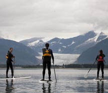 Visitors can try stand-up paddleboarding in Alaska with Blue Nose Surf // © 2012 Blue Nose Surf