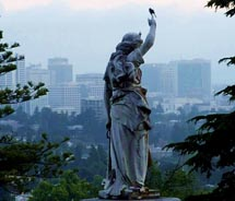 A statue at Mountain View with Oakland in the background. // (c) 2012 Visit Oakland