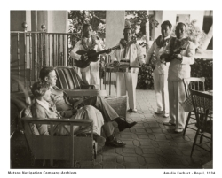 Amelia Earhart and her husband George Putman relax at The Royal Hawaiian during a visit to Waikiki in 1934. // (c) Matson Navigation Co. Archives