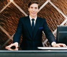 Experts advise that travel agents get to know hotel staff. // © 2012 Thinkstock