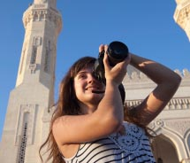 A girl takes photos at the Taj Mahal. // © 2012 Thinkstock