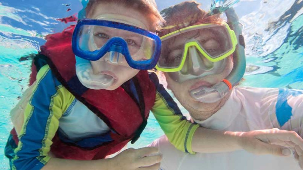 Fathers and sons can bond while exploring Hawaii's oceanic wonders. // © 2014 Thinkstock/shalamov 2
