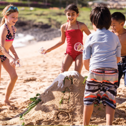 <p>Kids can build a sand volcano on the beach // © 2015 Four Seasons Hotels and Resorts</p><p>Feature image (above): Hawaii's kids' clubs offer...