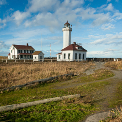 <p>Point Wilson Lighthouse in Fort Worden State Park // © 2015 Thinkstock</p><p>Feature image (above): There's a range of activities available to...