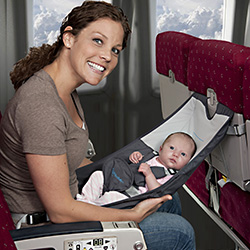 <p>FlyeBaby's baby sling can provide comfort when flying with a baby in tow. // © 2015 FlyeBaby</p><p>Feature image (above): Eliminate some potential...