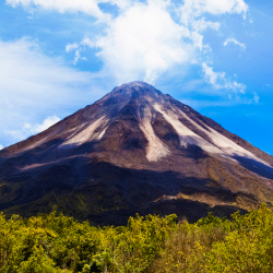 <p>On a clear day, clients staying in La Fortuna can catch a view of Arenal Volcano. // © 2016 iStock</p><p>Feature image (above): With all the hot...
