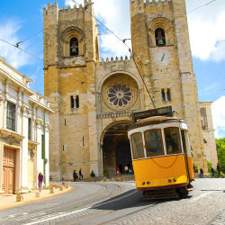 <p>Kids will love the city's yellow trams. // © 2017 iStock</p><p>Feature image (above): Travel light and pick up a Lisbon card to explore the city...