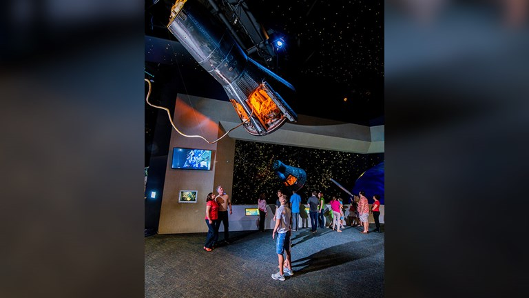 "At Space Center Houston, clients will see flown spacecraft including the Gemini V capsule that housed astronauts Charles ""Pete"" Conrad and Gordon Cooper."