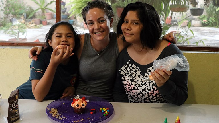 A Na'atik participant makes cakes with her homestay family.
