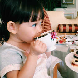 <p>The writer's daughter, Olivia, practiced her table etiquette at the most recent Imagine Tea. // © 2015 Chelsee Lowe</p><p>Feature image (above):...