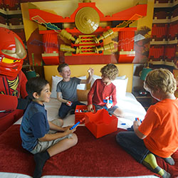 <p>Parents can sleep beneath a shrine to the four elemental weapons in Ninjago-themed rooms. // © 2017 Legoland California Resort</p><p>Feature image...
