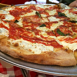 <p>Enjoy pizza and Brooklyn while on this teen-friendly pizza tour. // © 2016 Samantha Davis-Friedman</p><p>Feature image (above): Tour-goers get to...