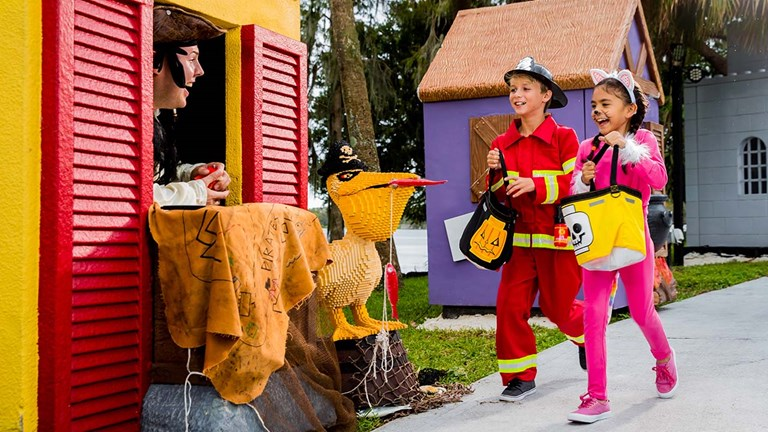 Kids can trick-or-treat for their favorite candy during Legoland's Brick or Treat Halloween events.